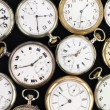 Various Antique pocket clocks on black background — Stock Photo #6529174