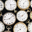Stock Photo: Various Antique pocket clocks on black background