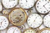 Various Antique pocket clocks on white — Stock Photo