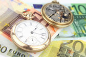 Antique pocket clock and money — Stock Photo