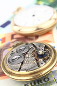 Clock mechanism with money background — Foto de Stock