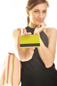 Young woman holding plastic card — Stock Photo