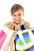 Jong meisje met shopping tassen — Stockfoto