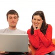 A happy couple surfing on a laptop — Stock Photo #5413659