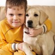 Little boy  and sweet puppy — Stock Photo