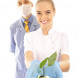 Young doctor and nurse with pills — Stock Photo