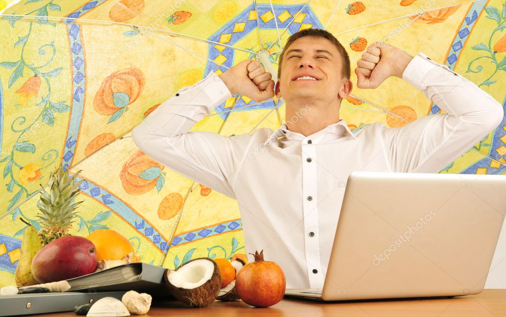 Young businessman having dreams about vacations — Stock Photo #5464390