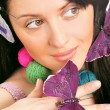 Closeup portrait of beautiful woman with wool balls - Stock Photo