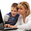 Portrait of adult woman watching as her son doing homework — Stock Photo #5661328