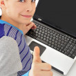 Portrait of a cute little boy using a laptop — Stock Photo