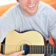 Young man with guitar — Stock Photo #5661377