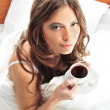 Royalty-Free Stock Photo: Fashion portrait of young elegant woman in bed