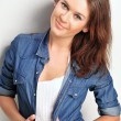 Stock Photo: Portrait of a beautiful young woman wearing a denim shirt, tuggi
