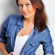 Stock Photo: Portrait of beautiful young womwearing denim shirt, tuggi