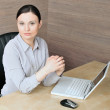 Portrait of a beautiful young businesswoman with hands clasped. - Stock Photo
