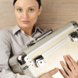 Portrait of a beautiful young businesswoman holding a suitcase. — Stock Photo