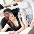 Royalty-Free Stock Photo: Portrait of two pretty women in an office environment working to