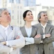 Portrait of three business outside. — Stock Photo