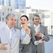 Foto Stock: Portrait of three business outside.
