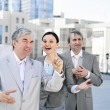 Stock Photo: Portrait of three business outside.