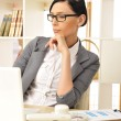 Portrait of a beautiful young businesswoman working. - Stock Photo