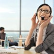 Portrait of a beautiful young businesswoman on the phone and hap — Stock Photo