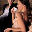 Fashion style photo of an attractive young couple — ストック写真