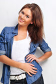 Portrait of a beautiful young woman wearing a denim shirt, hand — Stock Photo