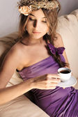 Young beautiful lady drinking coffee — Stock Photo
