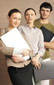 Portrait of three office workers. — Stock Photo