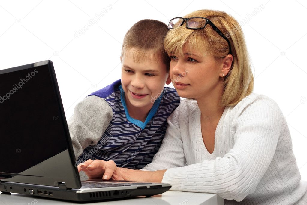 Portrait of adult woman watching as her son doing homework using his laptop and fast wireless internet. Copyspace. Isolated on white background  Stock Photo #5661328