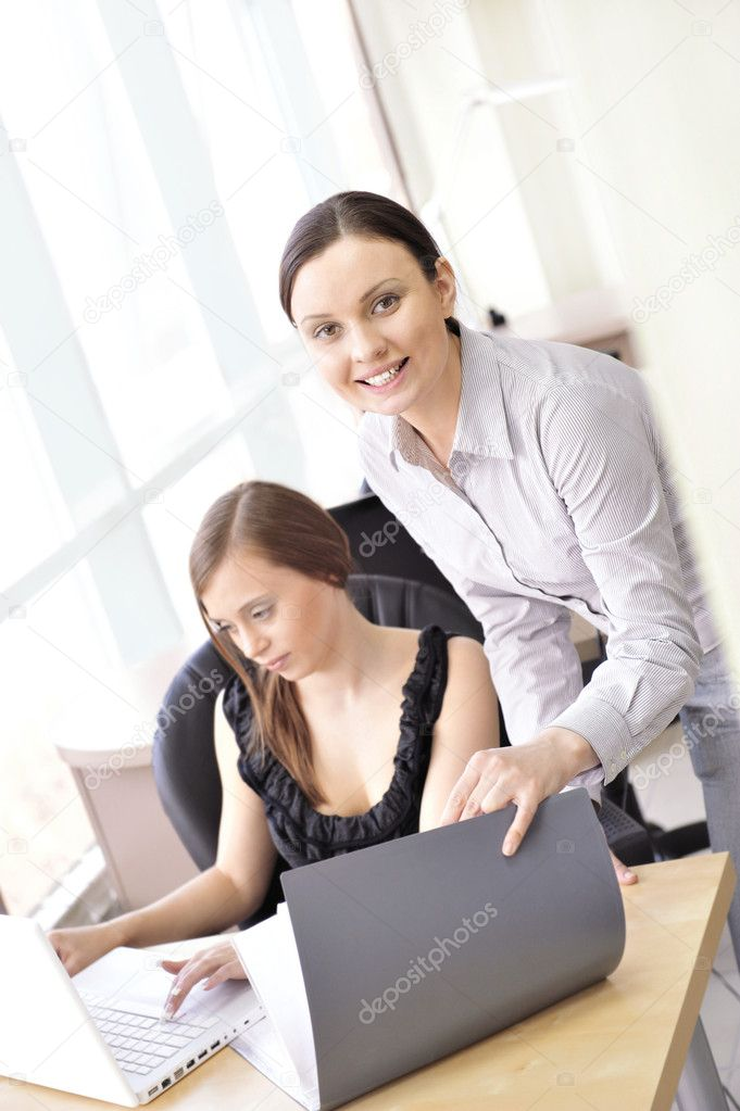 Portrait of two women reviewing data. Office background. — Stock Photo #5661612