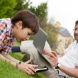 Man and young boy his son sitting outdoors — Stock Photo