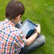 Young boy outdoors on the grass at backyard — Stock Photo
