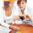 Portrait of two young women discussing construction project. — Foto de Stock