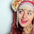 Closeup portrait of young beautiful woman wearing russian tradit — Stock Photo