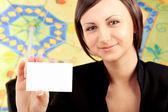 Closeup portrait of young pretty woman holding business card — Stock Photo