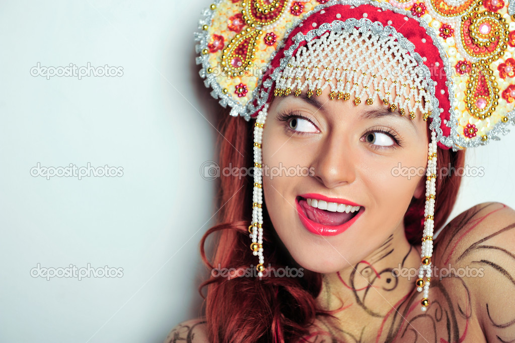 Closeup portrait of young beautiful woman wearing russian traditional hat kokoshnik. Advertisement banner for beauty and fashion industry with copyspace — Stock Photo #5756824