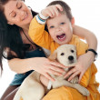 A happy family of two with a dog sitting on flor, looking at cam — Stock Photo