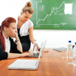 Portrait of two young business women at their office - Stock Photo