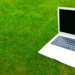 Laptop on grass — Stock Photo #5860869