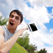Happy young man with a laptop outdoors — Stock Photo
