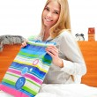Beautiful young blond woman on the bed at home — Stock Photo #5866578