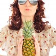 Closeup portrait of woman in sunglasses holding pineapple in her — Stock Photo