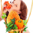 Closeup portrait of young pretty woman with basket of autumn har — Stock Photo #5866680