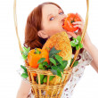 Closeup portrait of young pretty woman with basket of autumn har — Stock Photo #5866683