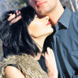 Young couple standig around in the nature - front view. - Stockfoto