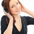 Beautiful woman with headphones, she is listen to the music — Stock Photo #5866725