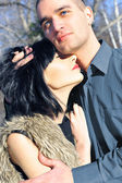 Young couple standig around in the nature - front view. — Stock Photo