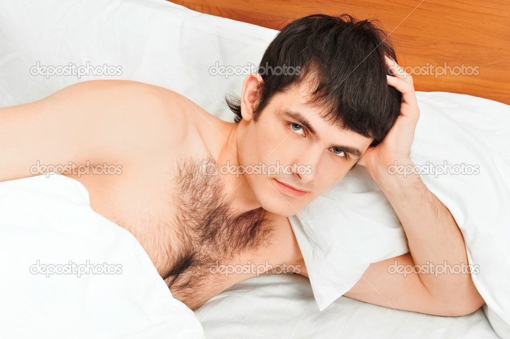 Man lying in bed smiling — Stock Photo #5866558